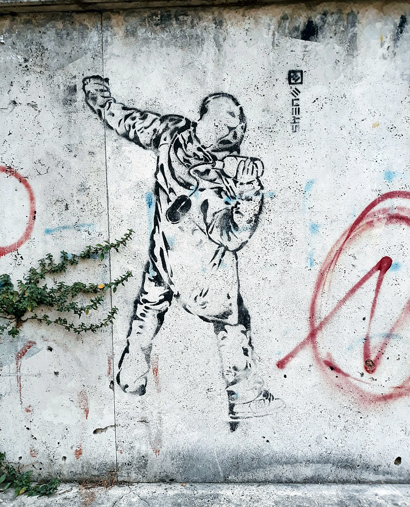 Stencil, Prenestino: Facebook Revolution. Rome. Italy.